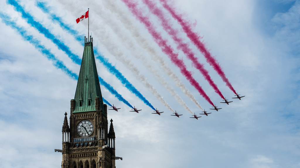 RAF Red Arrows flying past Parliament Hill in Ottawa, Canada, 13 August 2019.