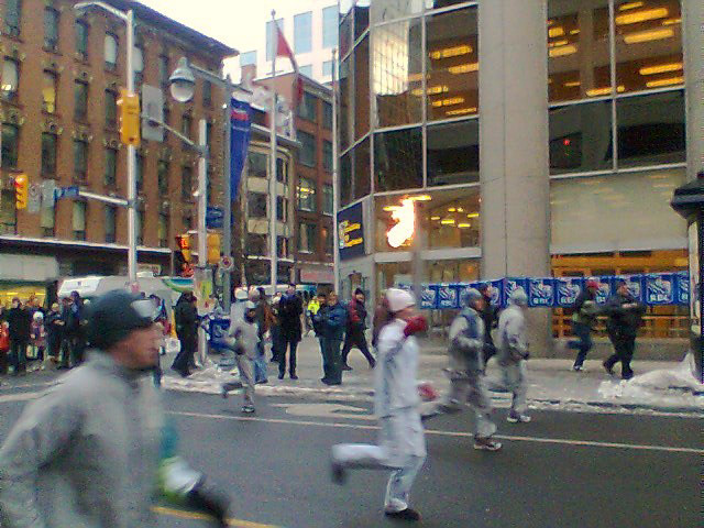 Olympic flame on its way to the 2010 Vancouver Winter Olympics, on Bank Street in Ottawa.