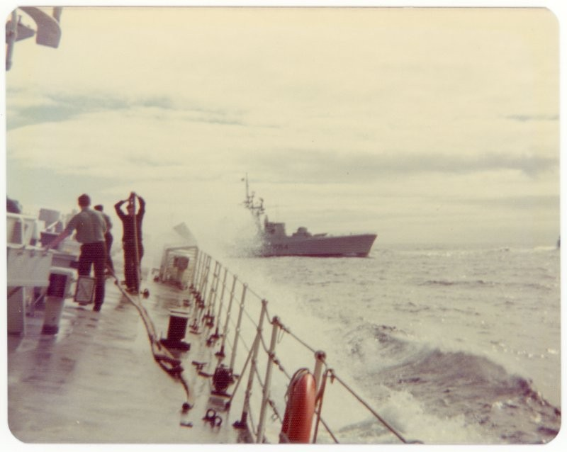 Morning deck evolutions aboard HMCS Mackenzie, HMCS Qu'Appelle off starboard bow, Pacific Ocean, 1975.